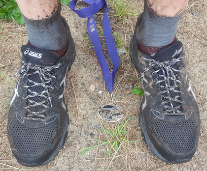 shoes, dirt, and medal